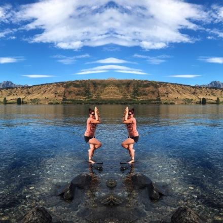 Garudasana pose on a lake