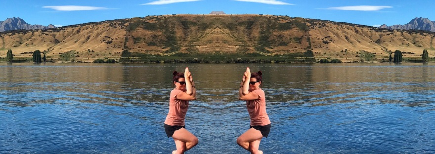 Garudasana pose on a lake