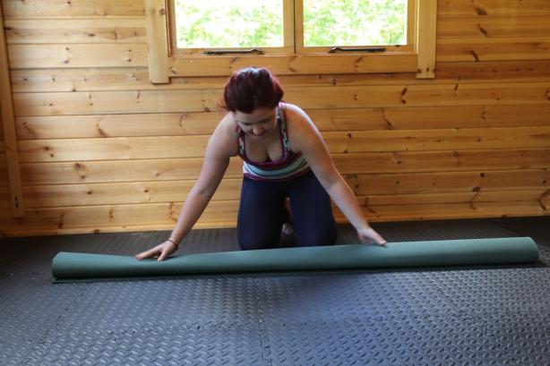 Rolling yoga mat up