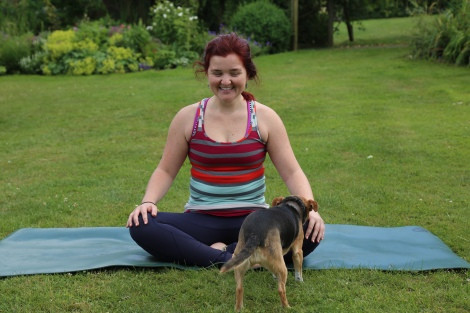 Cross-legged position with a dog
