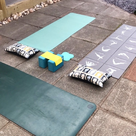 Outdoor yoga mats set up