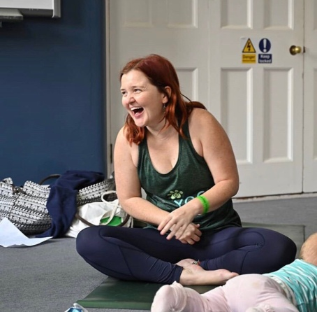 Parent and baby yoga laugh